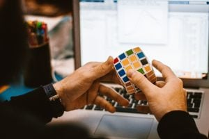 Person holds a multi-colored cube