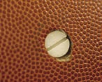 The battery-powered audible basketball designed by Burkholder and two other Engineering students emits a pulse tone to tell blind players where the ball is. The airtight cylinder in a Spalding Infusion ball offered a way to insert the electronics.