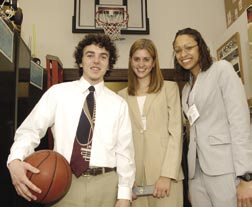 The system's inventors are Whiting School students (from left) Steve Garber '05, Burkholder, and Ashanna Randall '05 (who is also at top right). They provided details on their prototype system to the project's sponsor, Blind Industries and Services of Maryland, for possible further development.