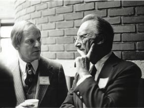 At the Whiting School's opening ceremonies 25 years ago, Hackerman (right) converses with F. Pierce Linaweaver '55, '65 PhD, who at the time was president of the Johns Hopkins Alumni Association.