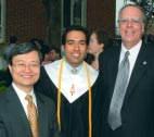 At Commencement in May, Roger Westgate (right) greeted Kwok-leung Li '79 (left) and Ravi Kavasery '03.