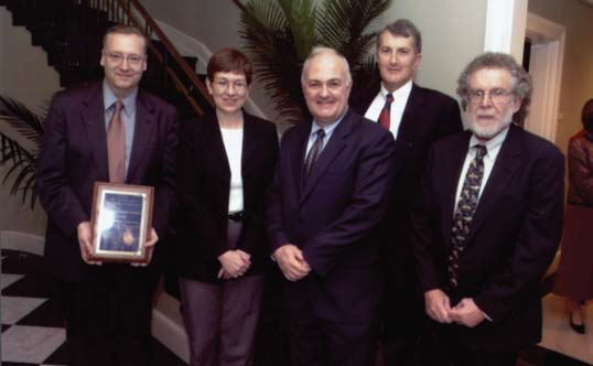 Dr. Carol Kovac (second from left), general manager of IBM Life Sciences, presented an IBM Life Sciences Institutes of Innovation award to Johns Hopkins University at a ceremony in Clark Hall in November 2003. Hopkins participants were (from left) Raimond L. Winslow, director of the Center for Cardiovascular Bioinformatics and Modeling; Steven Knapp, provost and senior vice president for academic affairs; Andrew S. Douglas, interim dean of the Whiting School; and Murray B. Sachs, director of the Whitaker Biomedical Engineering Institute.