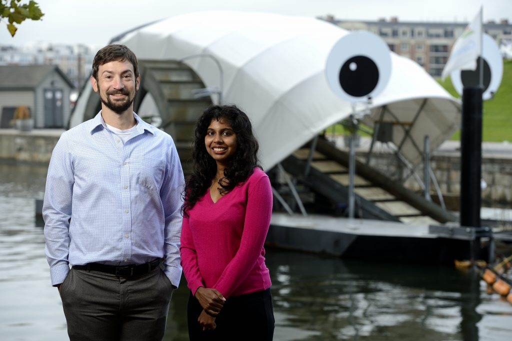 Chris Kelley and Ramya Ambikapathi stand in front of Mr. Trash Wheel