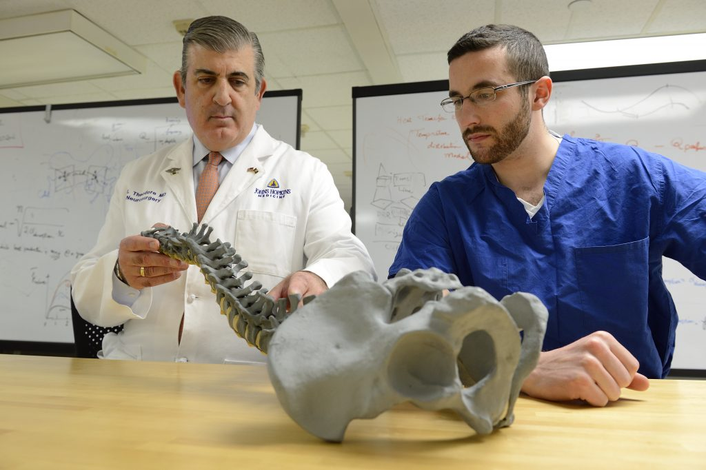 Nicholas Theodore, MD (left), director of the Johns Hopkins Neurosurgical Spine Center, advises David Gullotti.