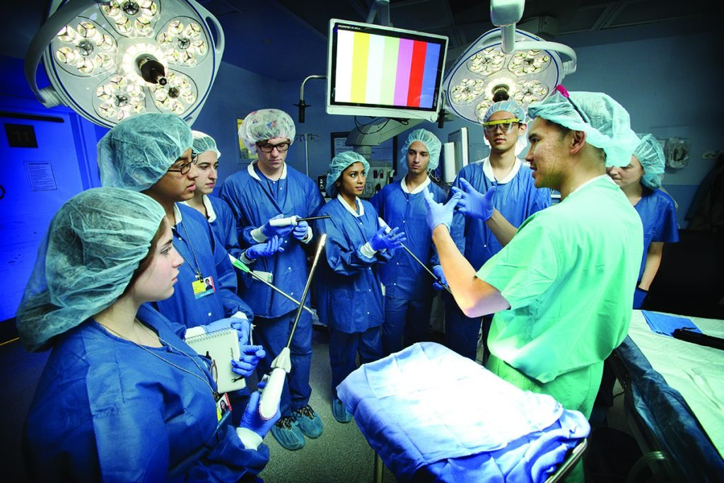 Hien Nguyen, assistant professor of surgery and biomedical engineering, walks through a surgical procedure with a group of undergraduate Design Team leaders in an operating room at Johns Hopkins Bayview Medical Center.