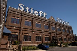 A photo of the Stieff Silver building from the parking lot on a clear day.