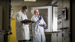 Two scientists inspect a sample