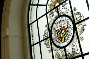 Johns Hopkins University seal in a stained glass window